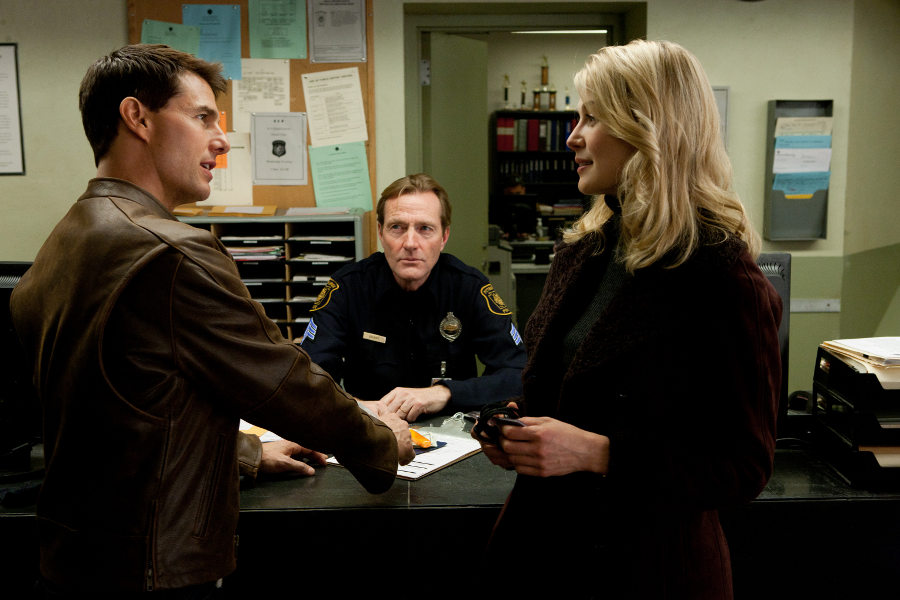 Film still of Tom Cruise, Lee Child and Rosamund Pike from the film Jack Reacher, adaptation of Lee Child's One Shot